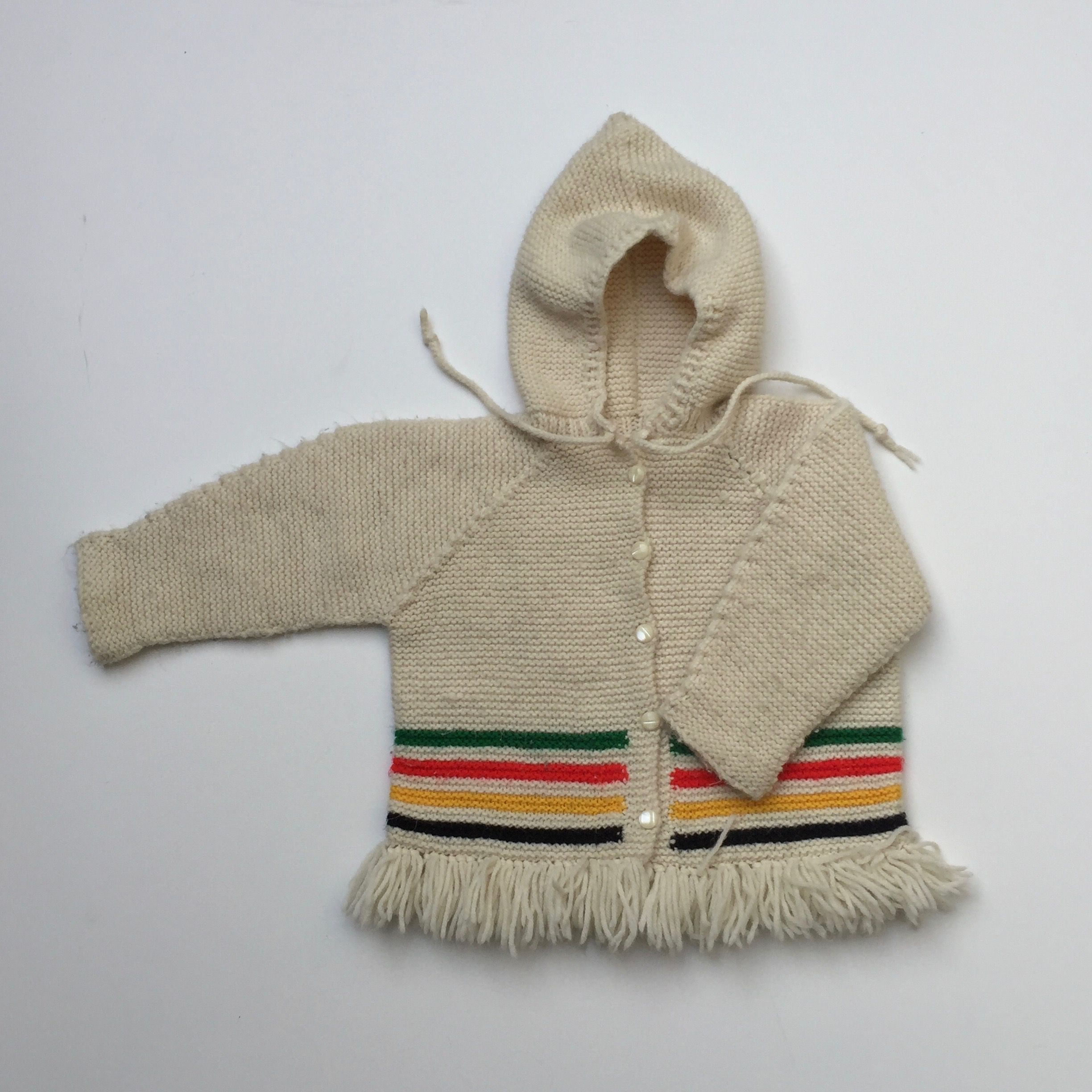 """Hand knit hooded sweater coat. Approximate size 2/3T. Please refer to measurements for best fit. Measures 15"""" pit to pit and 15"""" shoulder to hem."""