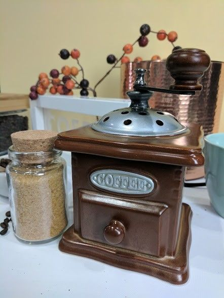 Modeled after an old-fashioned coffee grinder, this warmer embodies the vintage, antique-shop ...