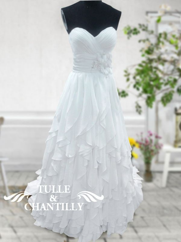 intricate tiered chiffon wedding dress with beaded floral embellishment