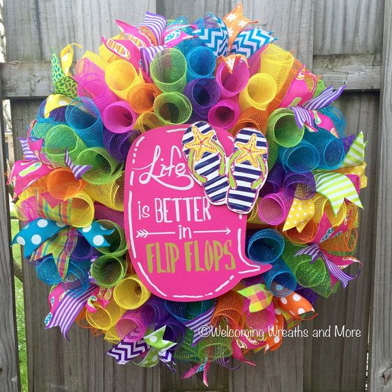 This bright and colorful flip flop deco mesh wreath will give your door a fun and playful look this Summer!  This large, full wreath