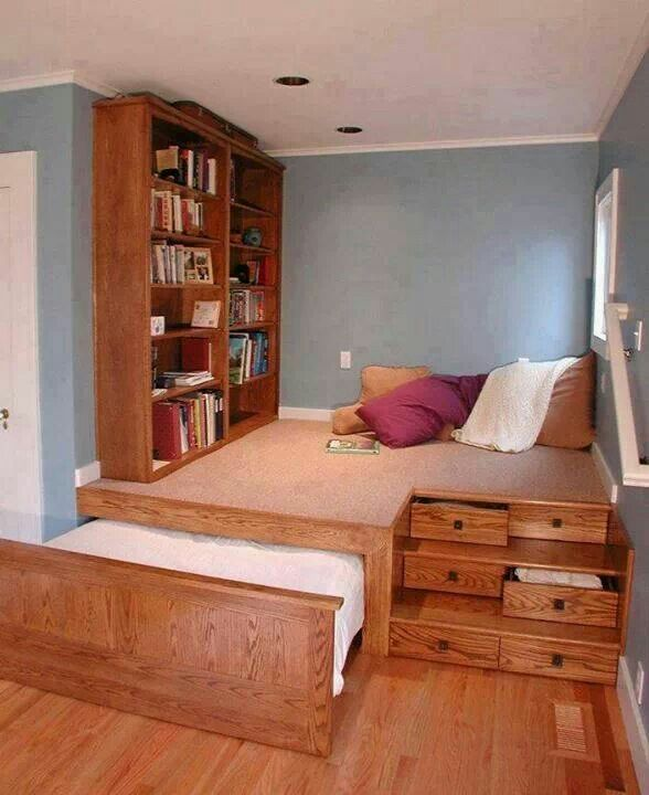 Awesome reading space. Love the pull out bed and the draws on the steps