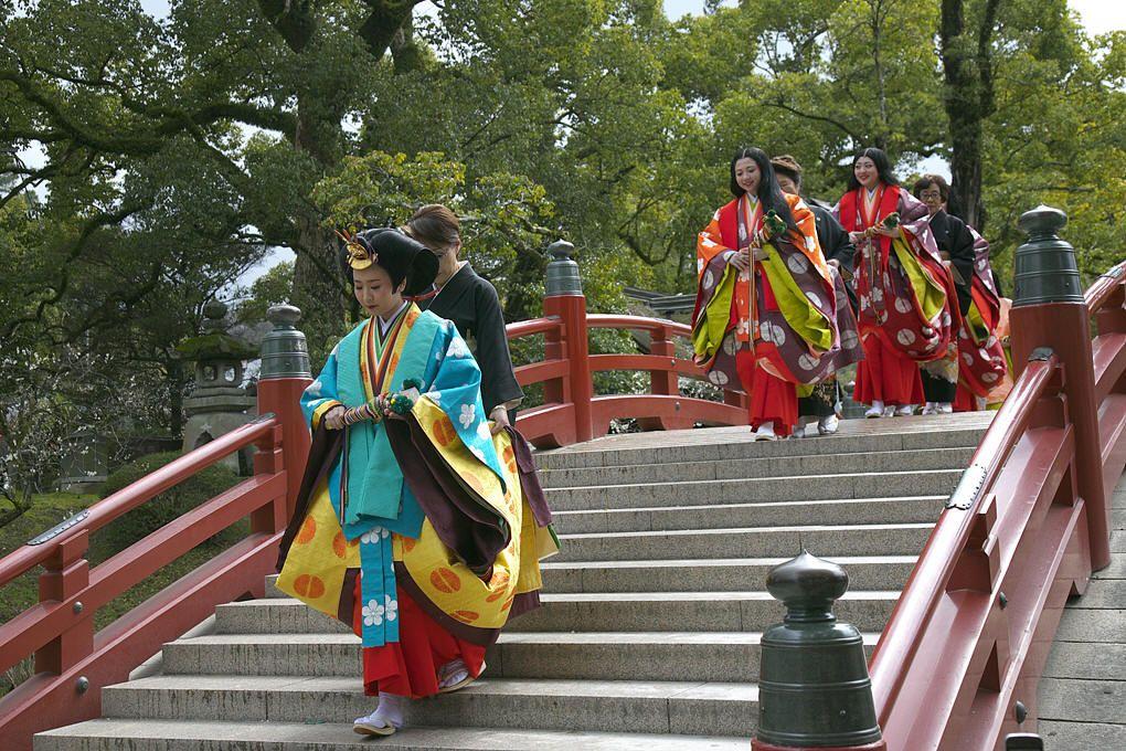 Women dressed in junihitoe.