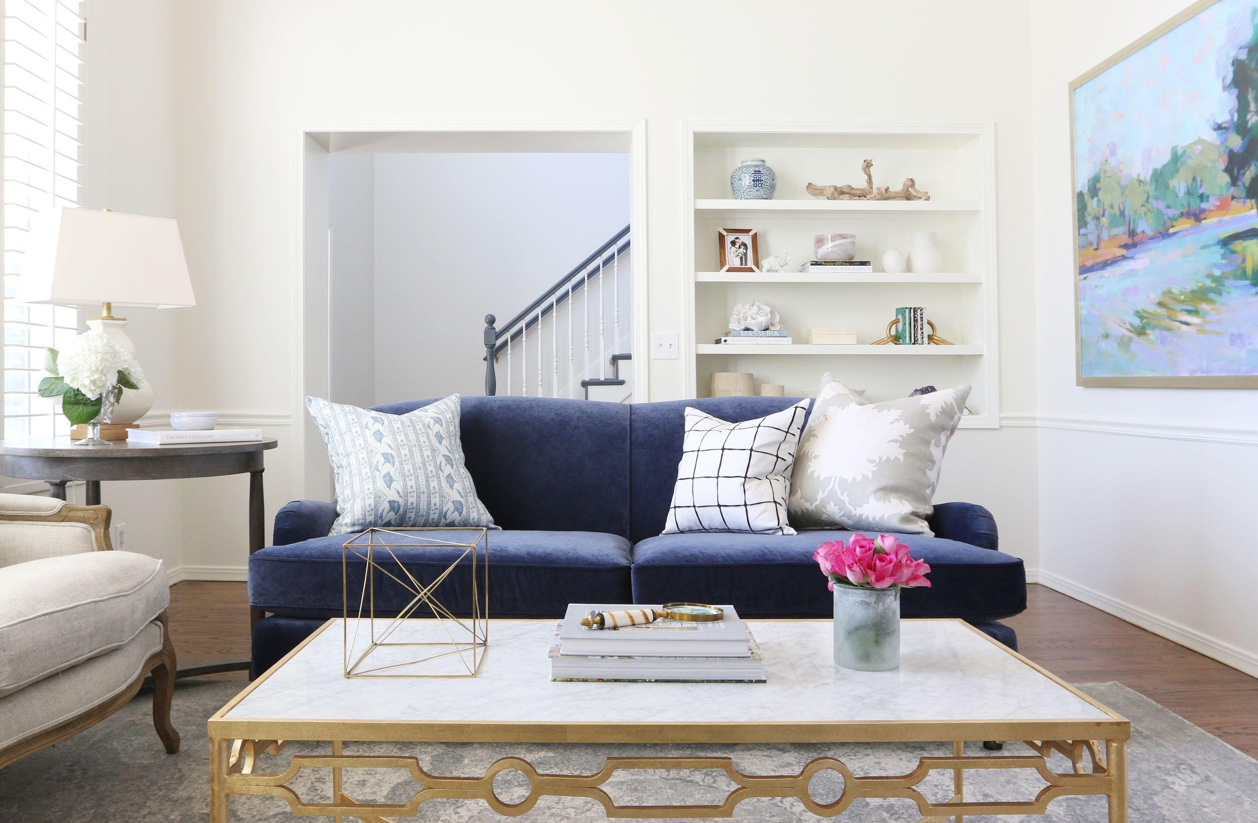 Navy velvet sofa living room by studio mcgee