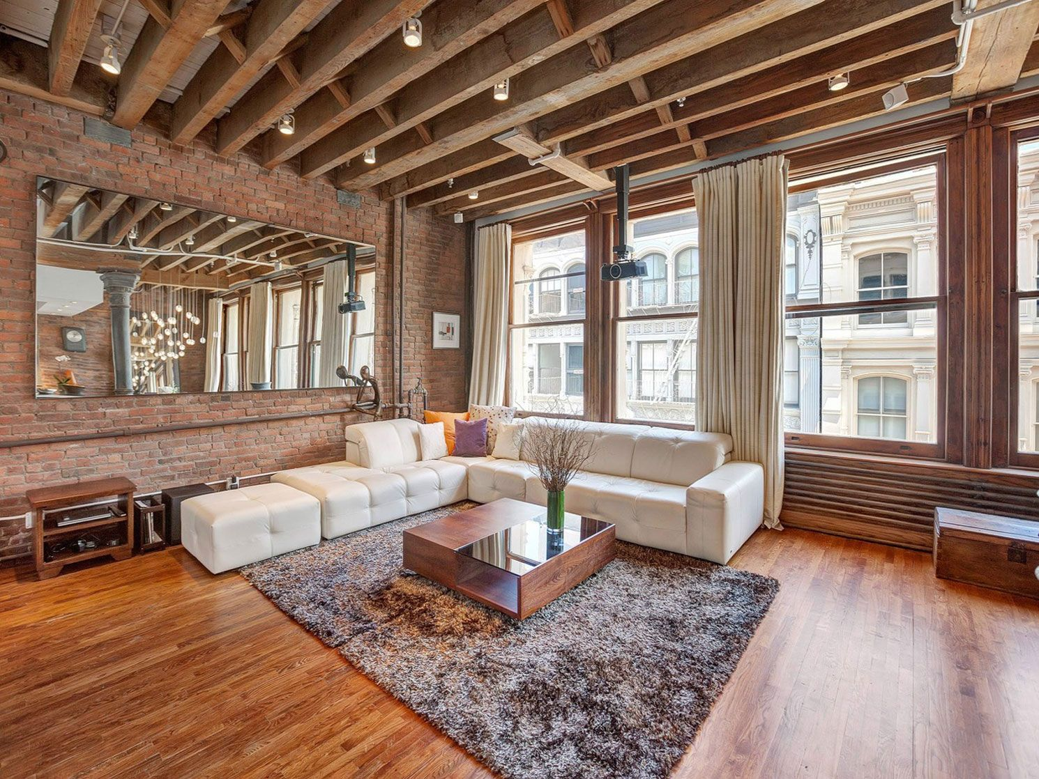 Open Plan Apartment With Exposed Wood Beams And Iron Columns Loft Apartment Decorating Brick Living Room Loft Design