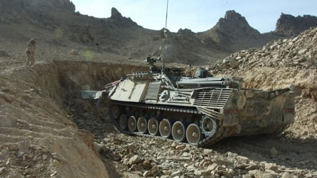 A Badger Armoured Engineer Vehicle Is Digging A Hole In