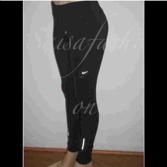 """Nike stay warm - dri fit reflective legging Nwt. Sz small or medium. Ankle zip. 29"""" Inseam.  100% Polyester Dri-Fit fabric helps keep you dry and comfortable. Comfortable, wide elastic waistband. Drawstring waist. Zip shut rear pocket. Reflective stripe detailing. Flat-seam construction. Zoned mesh. 88% Polyester, 12% Spandex. Color: Black Nike Pants Leggings"""