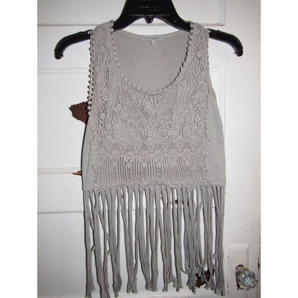 Stranded crop top This has a lot of textured patterns on the front sewn and lots of thick strands hanging down and has only been worn once. Charlotte Russe Tops Crop Tops