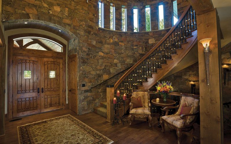 Narrow Foyer Stairs : Love the curved stone wall and row of tall narrow windows