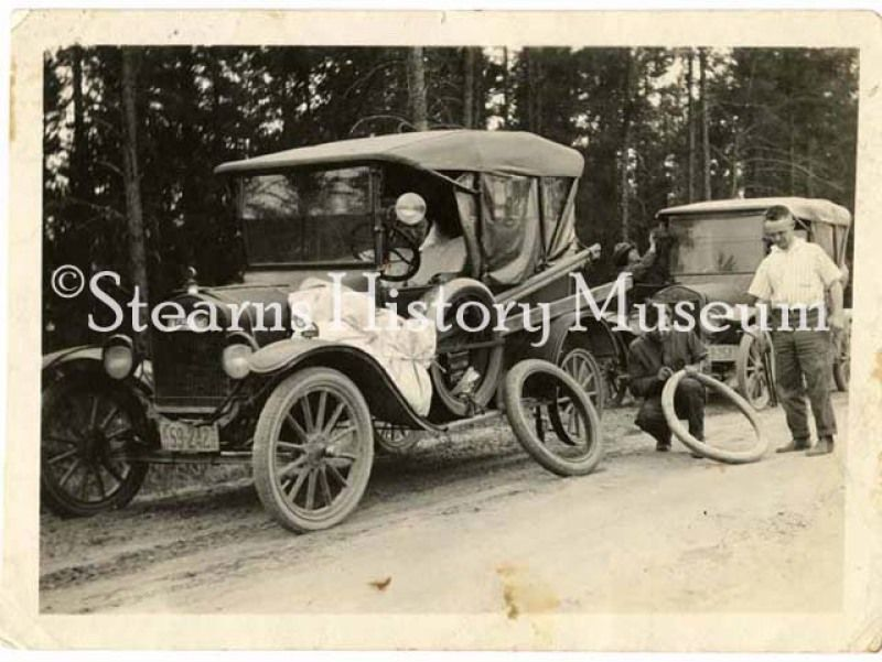 Fixing a flat tire, ca.1920 minnesota historicphoto