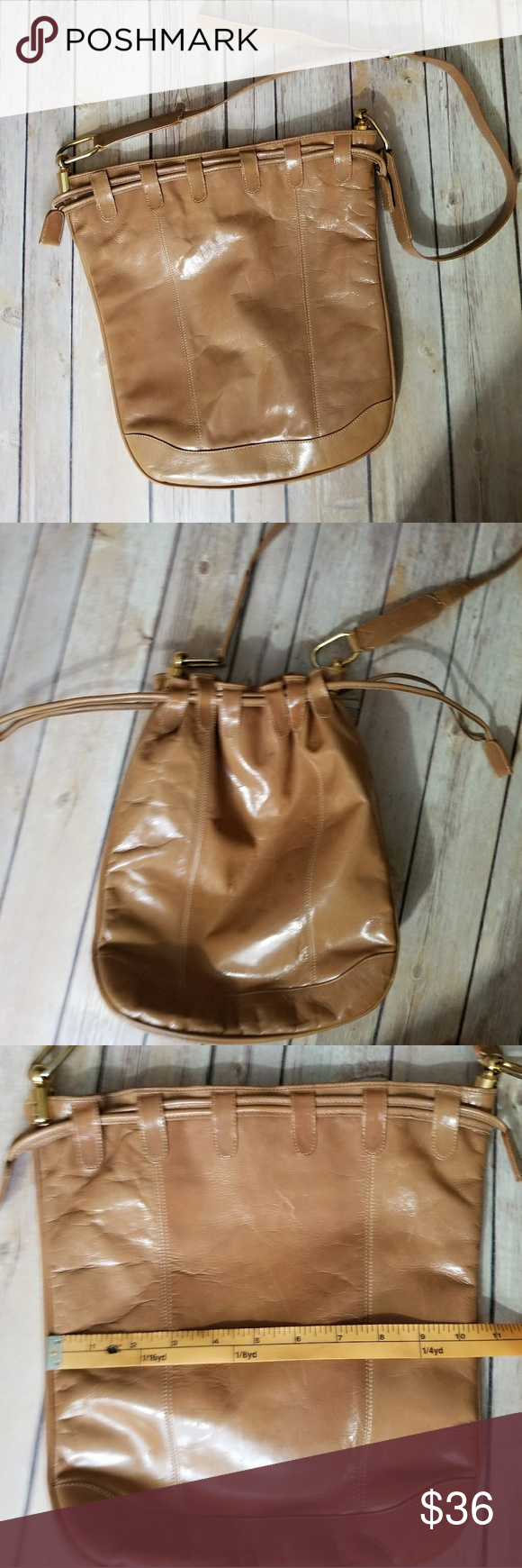 BORSA BELLA vintage leather bag Vintage tan leather bag with drawstring top. Adjustable strap. Gold toned hardware. Snap closure. Great condition except for some tearing of one strap hole as shown in last photo Borsa Bella Bags