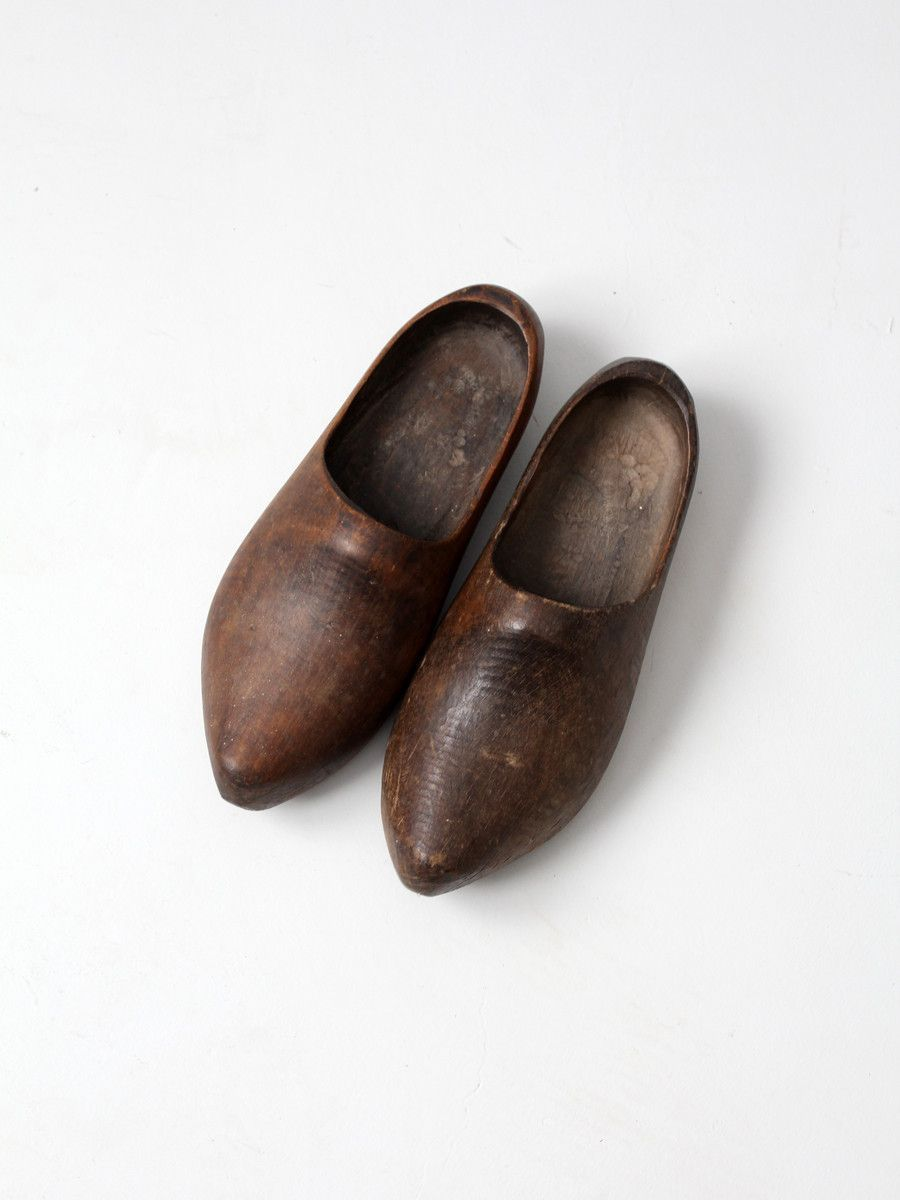 61f0575320805 A beautiful pair of antique hand-carved wood clogs. The whole-feet ...