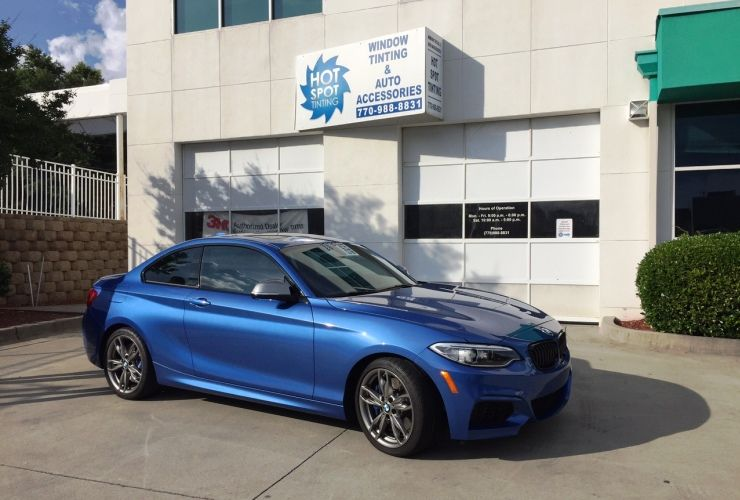 BMW M2 with blue paint and LLumar window tint film. Hot