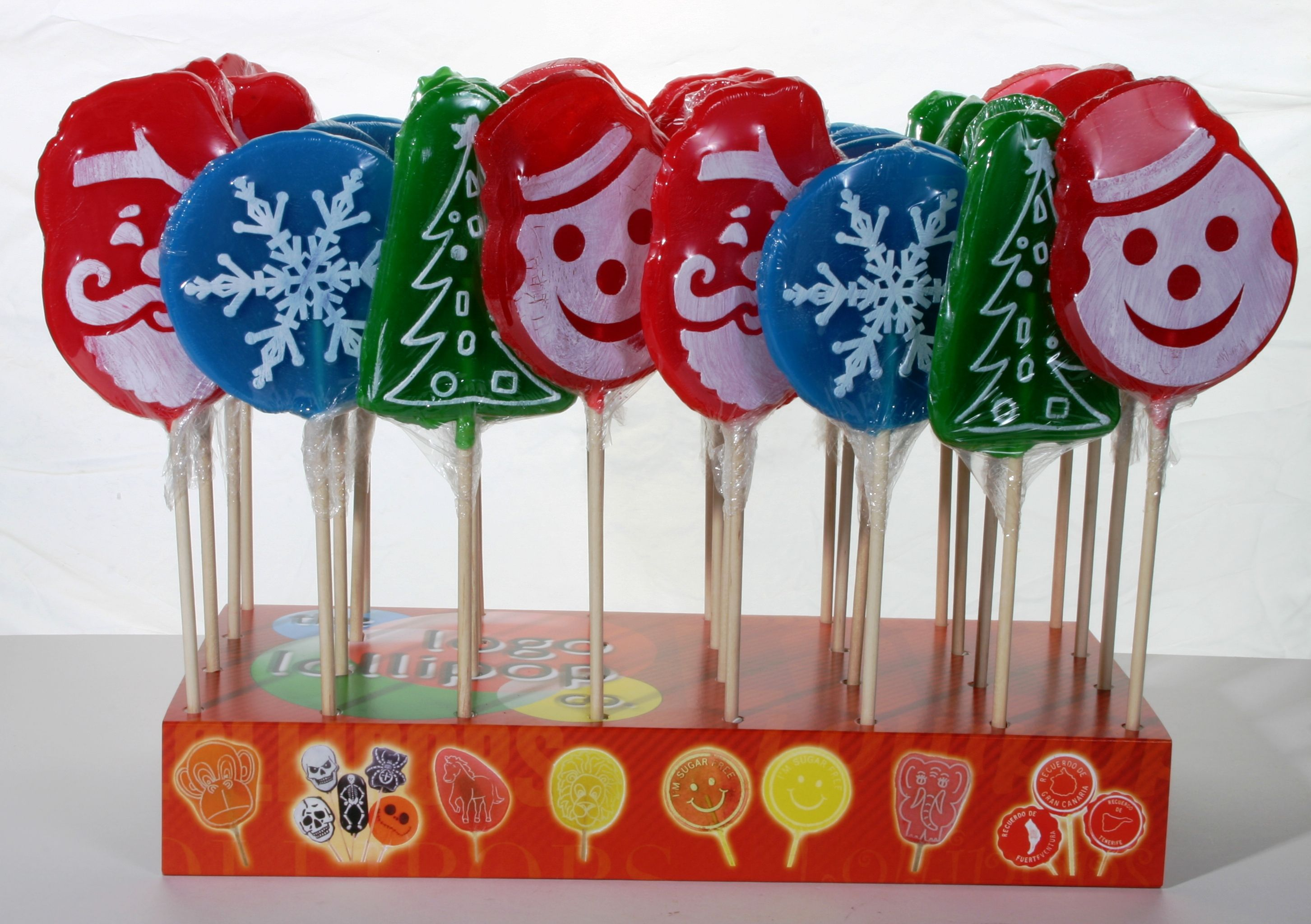 A selection of our Christmas-themed Logo Lollipops. Christmas lollies, rock candy, favours, personalized sweets, sweets, rock sweets, customizable candy, sweet shop, sweetie, Bonbonnier, party sweets, hard candy, unique gift, candy buffet, candy table, treats, lollipops