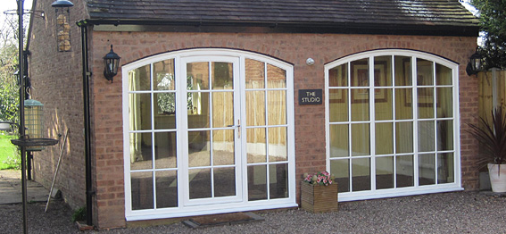 Added Big Window And Glass Door That Can Easily Be Replaced With Garage Doors Garage Bedroom Conversion French Doors Garage Bedroom