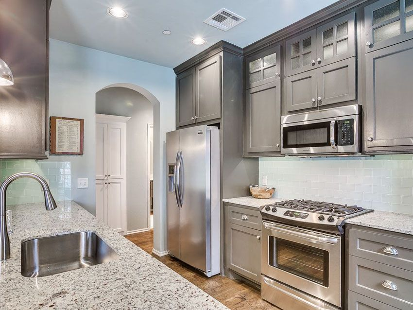 Small Galley Kitchen With Gray Cabinets Andino White Granite And Light Blue Subway Tile Bac Galley Kitchen Design Gallery Kitchen Layout Small Galley Kitchens