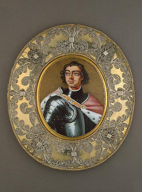 Frame with silver filigree of round Miniature Enamel on Cooper by unknown artist abt 1700 of Tsar Peter I The Great Alekseyevich Romanov (9 Jun 1672-8 Feb 1725) Russia. In 1945 in The Leningrad State Purchasing Commission, Leningrad, Russia.