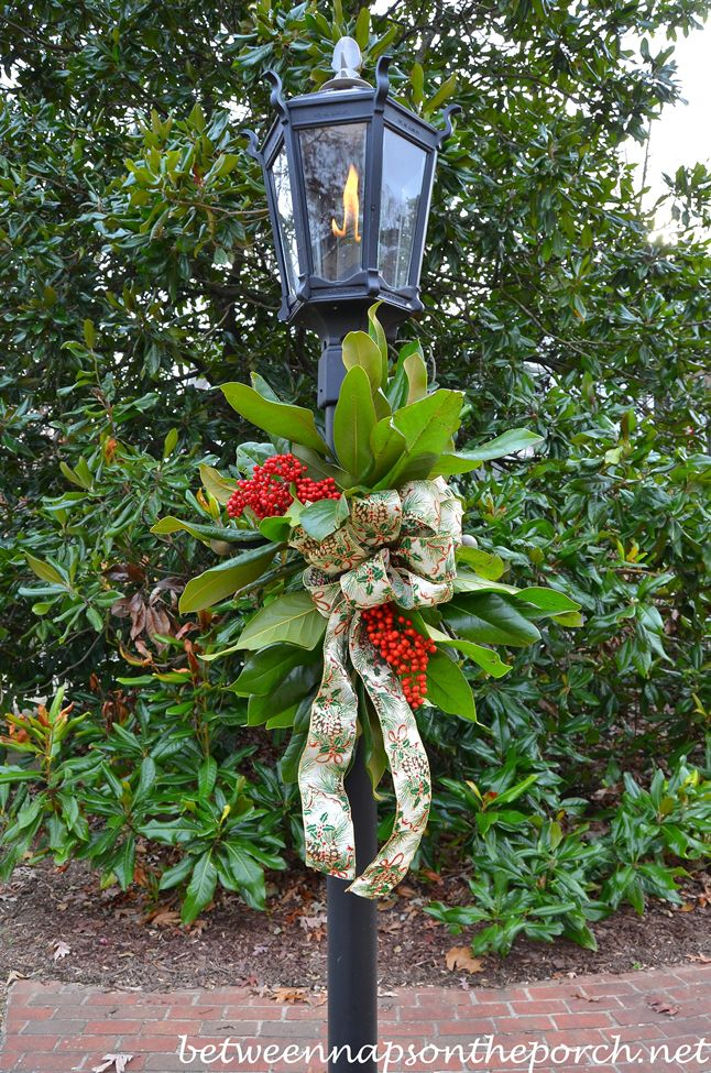 decorate a lantern for christmas with greenery from the garden