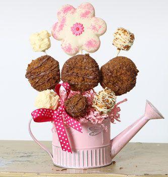 Christy's Gourmet Gifts, Burlington, ON   Watering can cookie bouquet.   #cookie #cookiearrangement #spring #springtime
