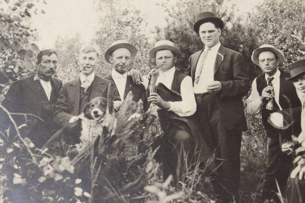 Vtg Photo Postcard Men outside Smoking & Drinking Dog