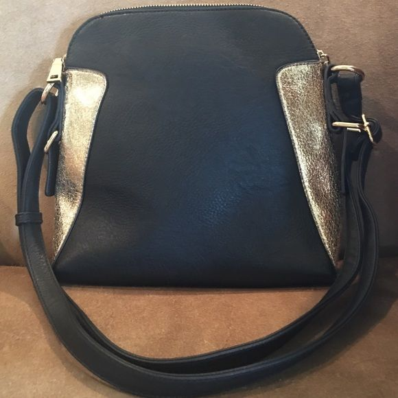Faux leather handbag Gorgeous black and gold Faux leather handbag with gold color hardware. Shoulder bag brand new never worn with adjustable straps to use as a cross body bag.  new WO tags. Bags