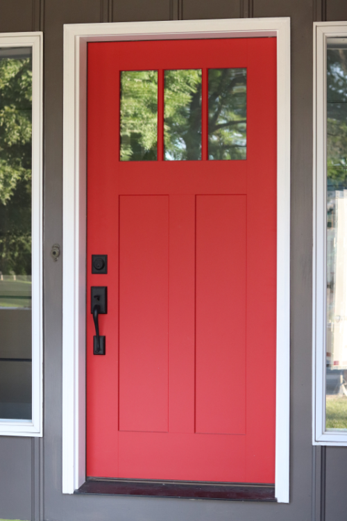 Coral Red Front Door On A Charcoal Grey House Painted Front Doors Coral Front Doors Exterior Door Colors