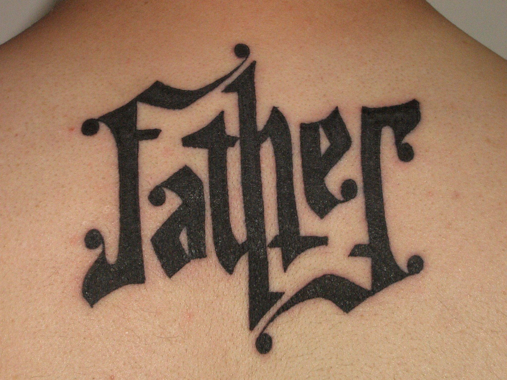 Ambigram tattoo designs for women ambigram back tattoo design for women 2011