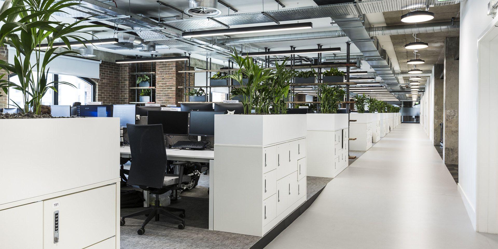 Amazing office with contemporary lighting, open brickwork