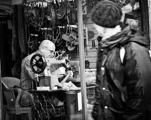 THE AMERICANS: STREET PHOTOGRAPHY PROJECT, Shoemaker Inside the Glass Window