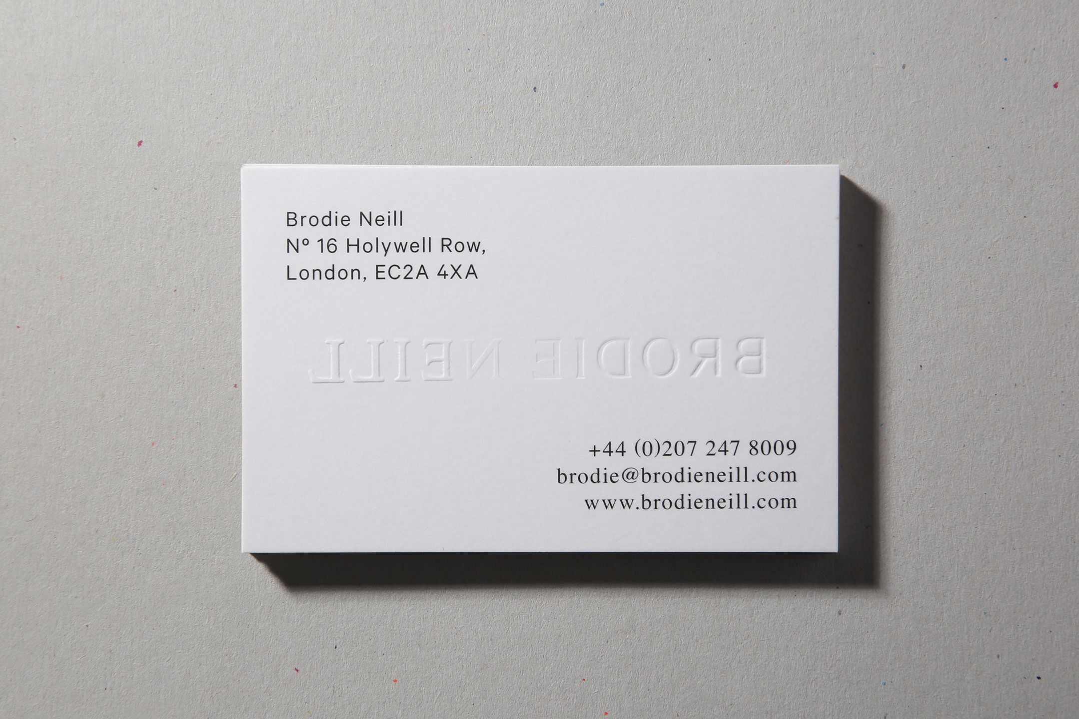 Bro Neill visual identity and blind emboss business card by