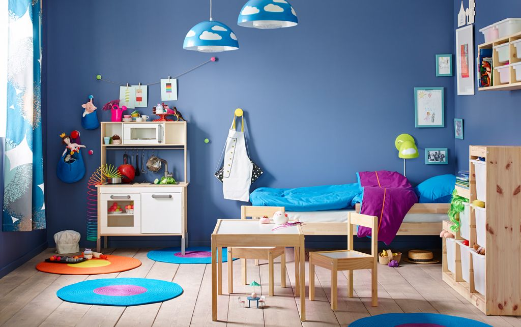 A Small Children S Bedroom Furnished With Pine Bed Bedlinen In Turquoise And Lilac Shown Together Play Kitchen Table Two