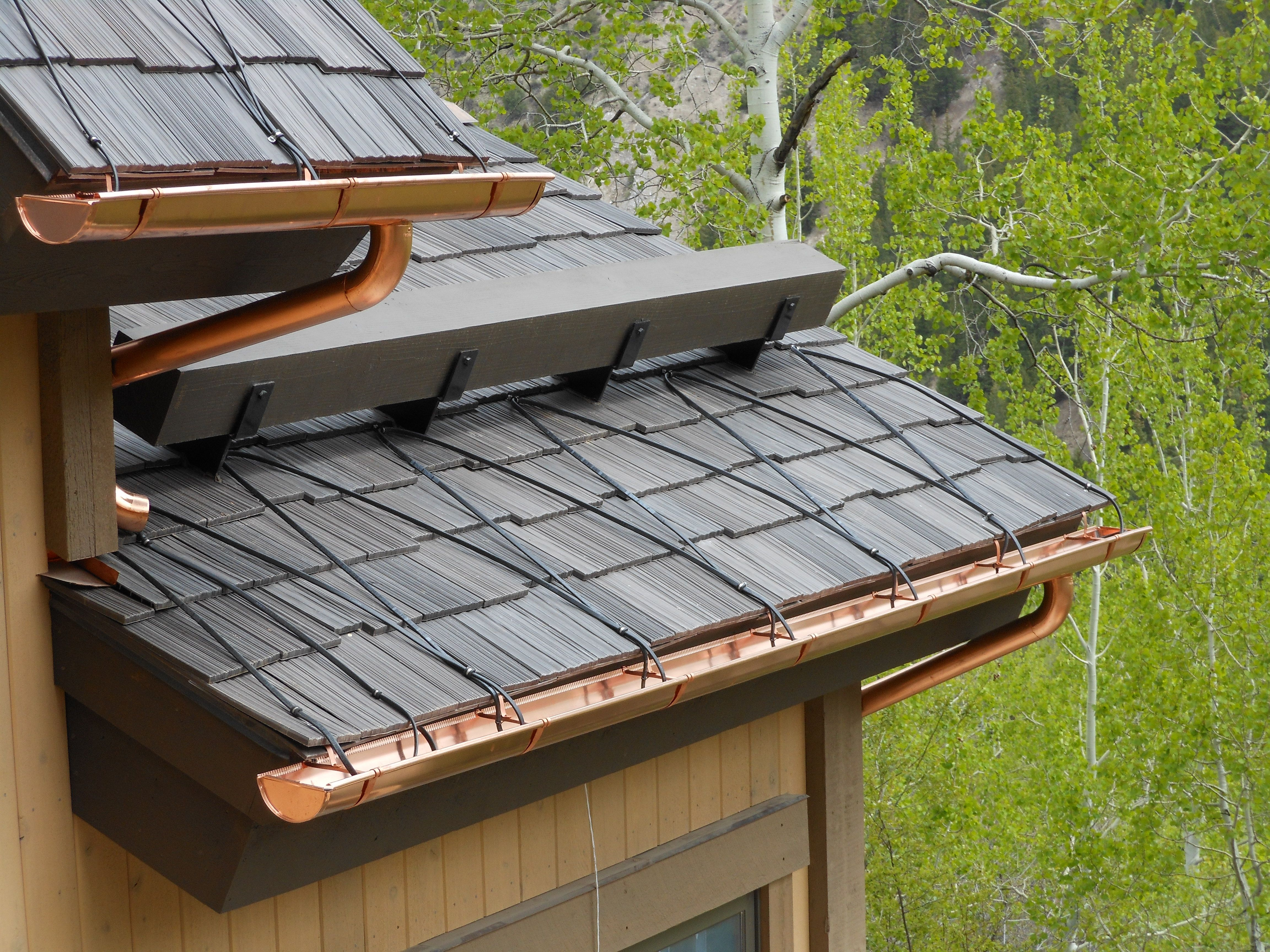 Close Up View Of The Synthetic Shake Roofing Tiles Cooper Gutters And Downspouts Solar Panels Roofing Coffee Table