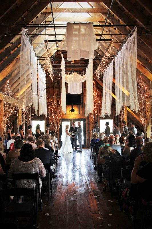 Rustic Barn Wedding Ceremony With Twinkle Lights And Hanging Drapes Stonewall Farms I Minnesota Wedding Minnesota Wedding Venues Wedding Reception Locations