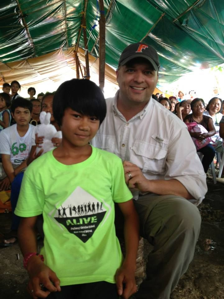 Bobby and one of our young people/Sunday school teacher with a Southwest Christian School t-shirt Bobby helped us ship to the Philippines.