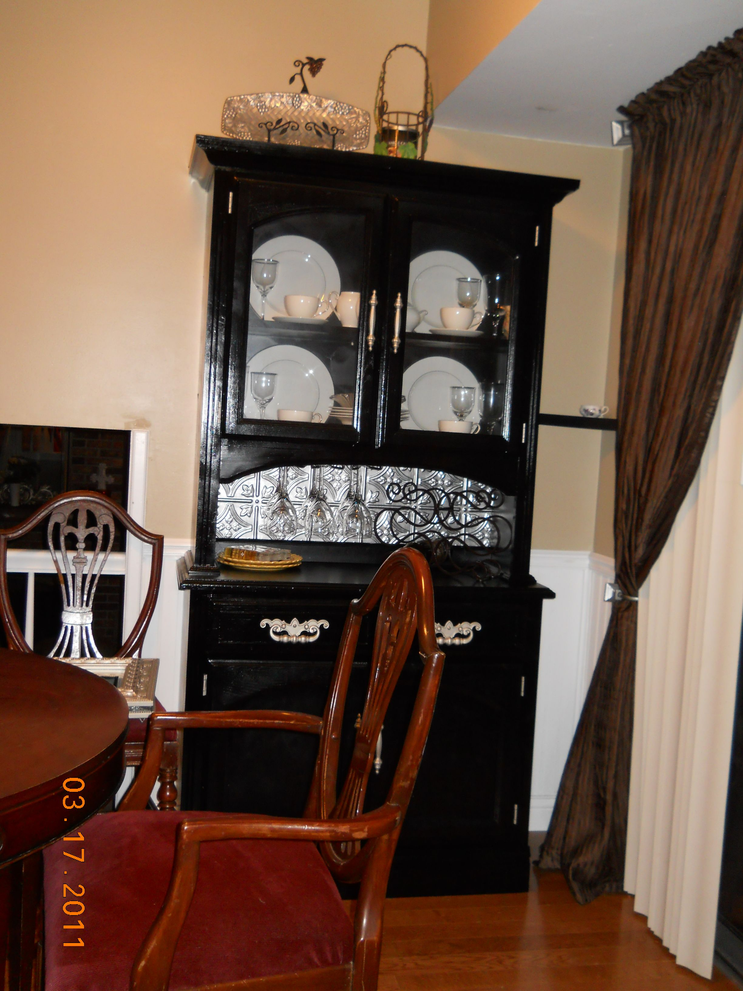 My repurposed china cabinet painted it added the backsplash and wine
