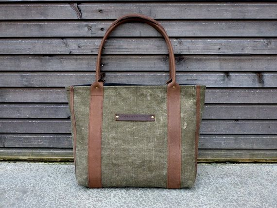 Nice design - but looks like it would be heavy!  made from recycled vintage canvas made into a carry by treesizeverse on Etsy, $139.00