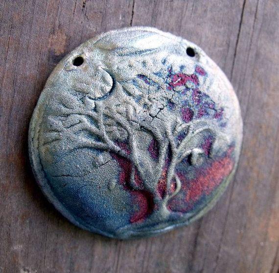 "Raku pendant by ""Wondrous Strange Designs"""