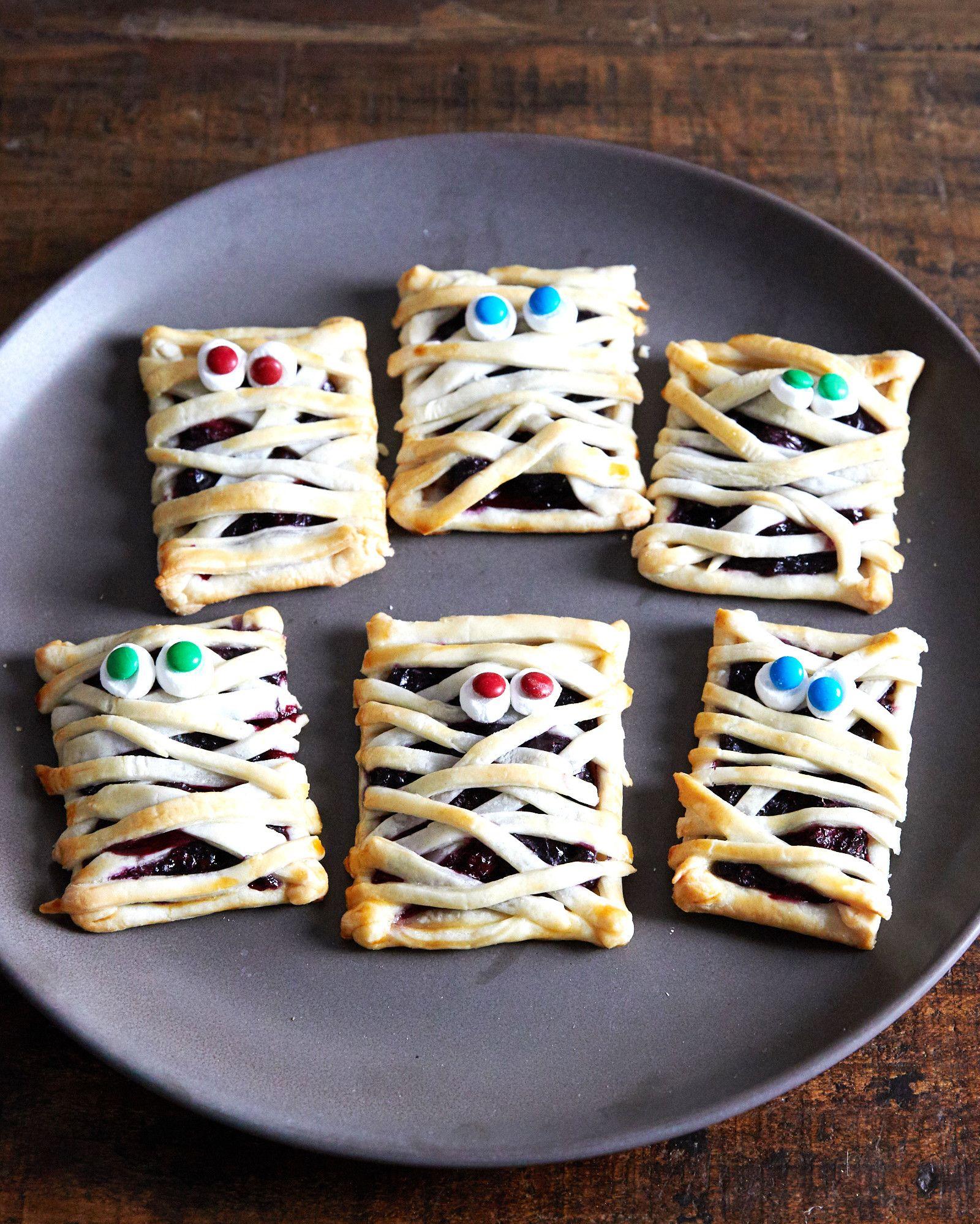 Halloween Mummy Hand Pies Make A Berry Frightening Treat
