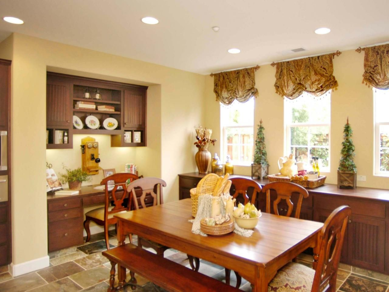 Country style breakfast area displays elegant farmhouse charm. This ...