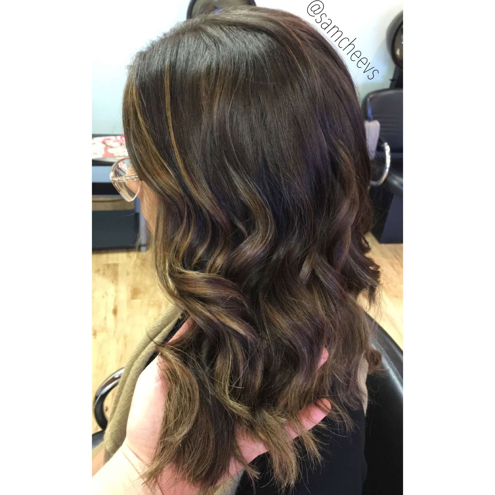 Dark brown hair color with honey blonde highlights. Hand ...