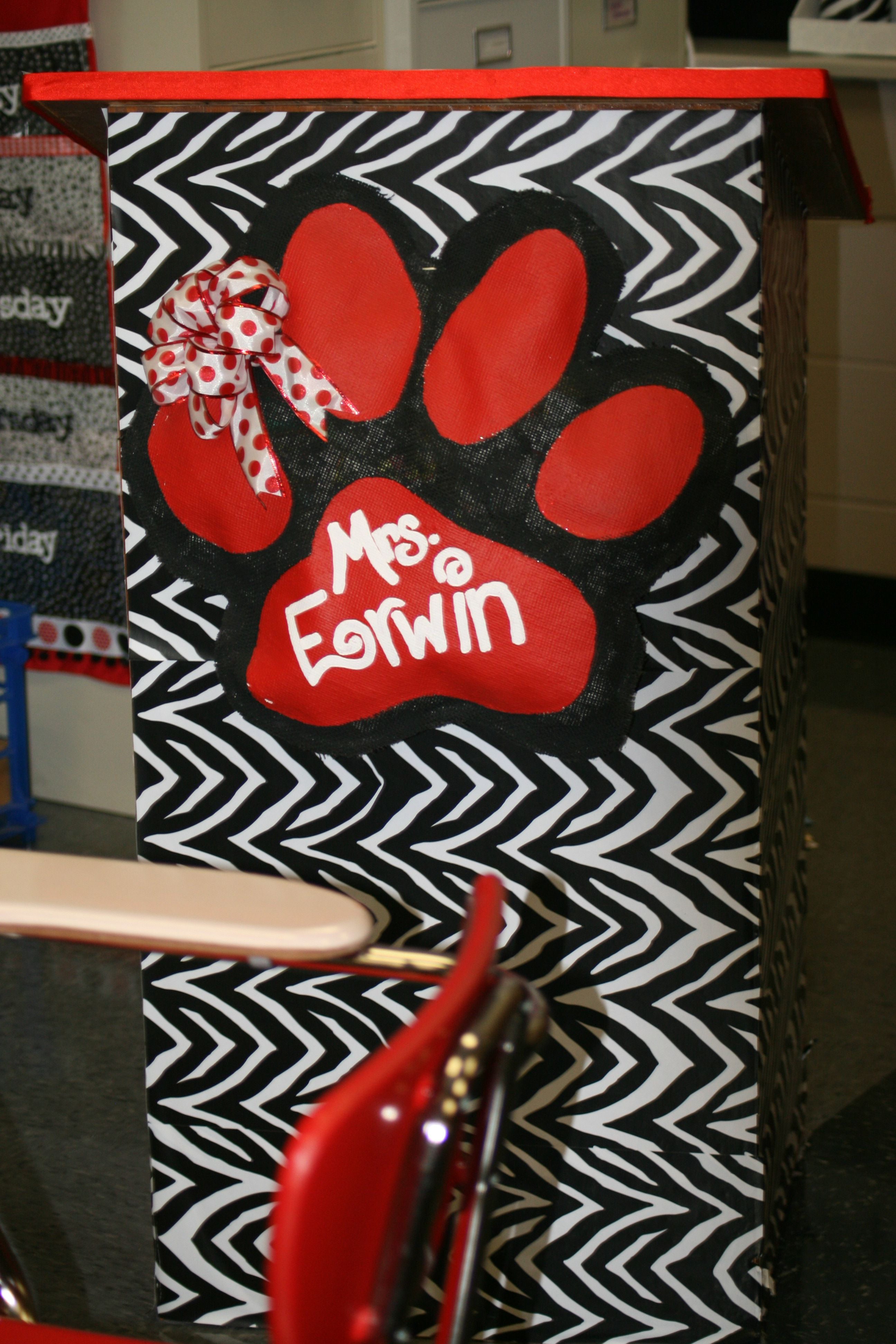 My podium!  I used contact paper purchased from TJ Max to cover the podium.  I made the paw print from burlap, paint, and ribbon.