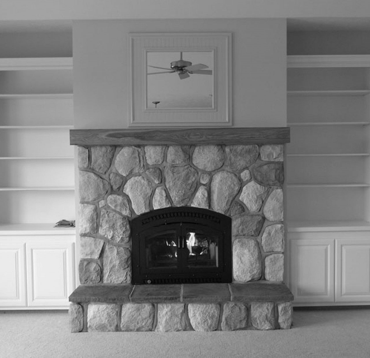 Stone WB stove with recessed storage either