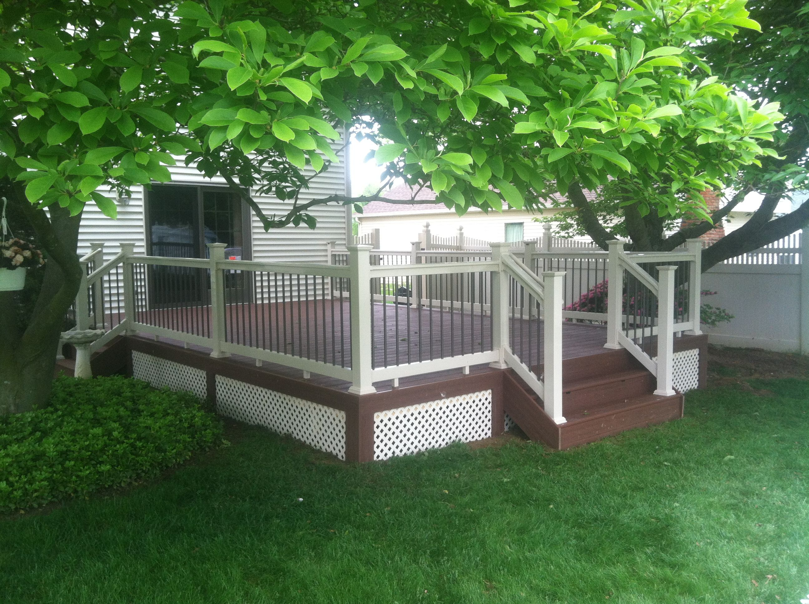 Ampro brazilian redwood pvc decking tan deck teck rails with ampro brazilian redwood pvc decking tan deck teck rails with black aluminum balusters at great railing we like to make big dreams come true baanklon Image collections