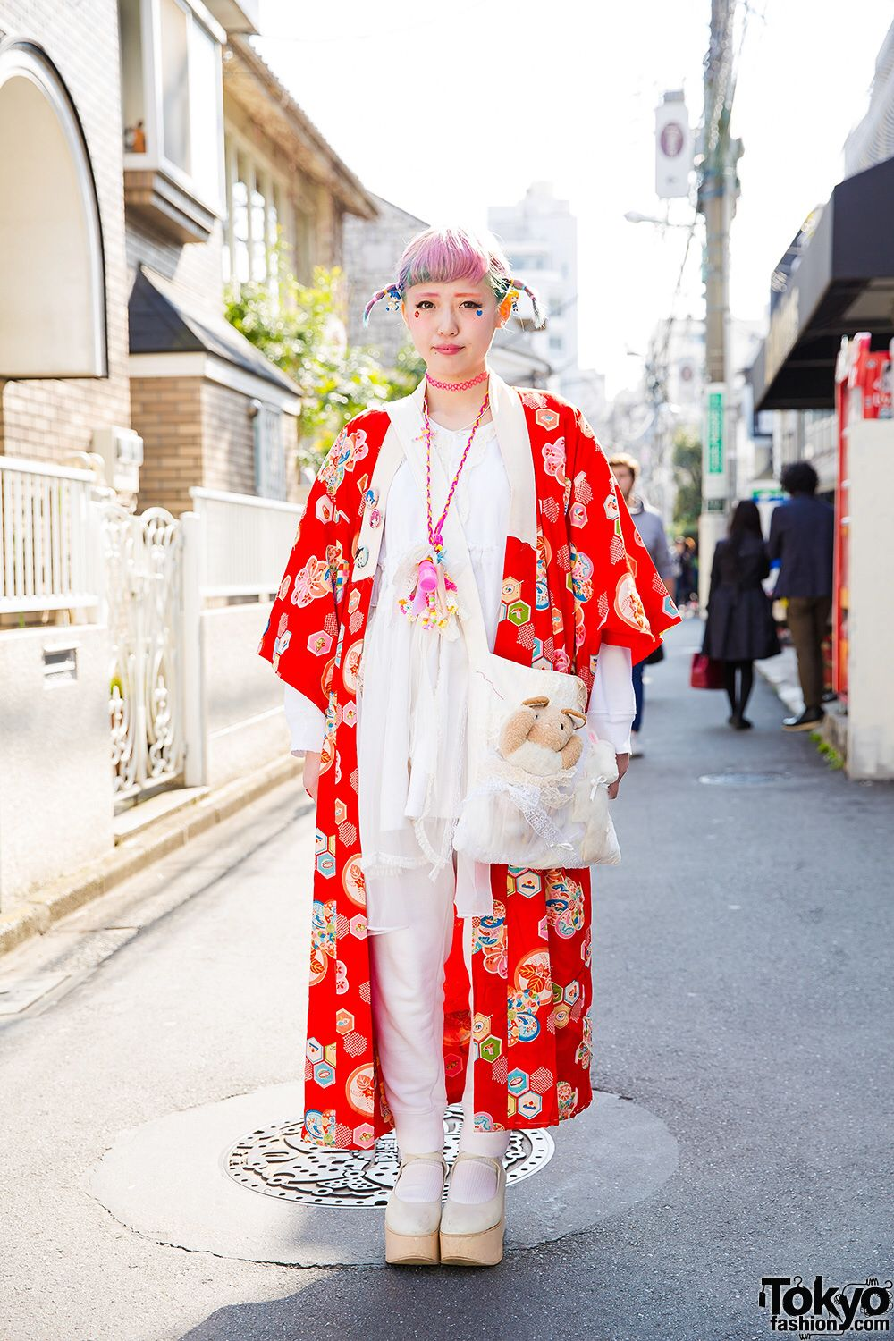21-year-old Am on the street in Harajuku wearing a resale kimono over a Gunifuni babydoll top, Tokyo Bopper platforms, a handmade bag, and anime/manga accessories.