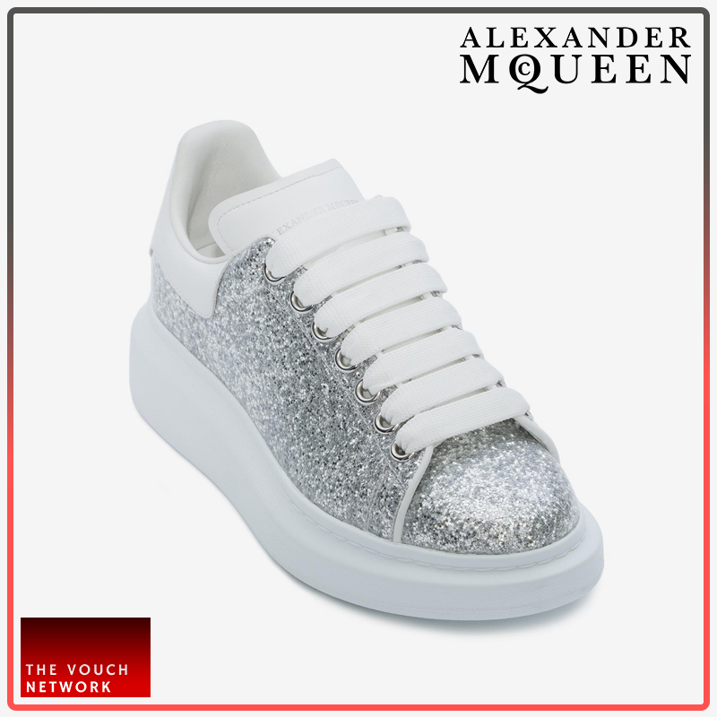 b14520a7f5da Patent silver glitter lace-up sneaker trimmed with white leather. The sneaker  features large