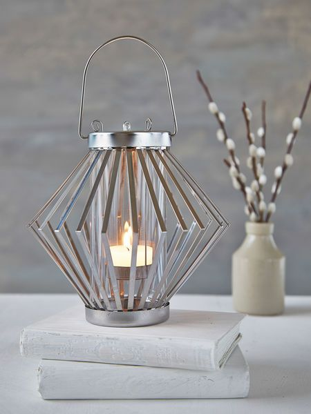 Place a tealight inside our elegant round silver candle lantern and place a tealight inside our elegant round silver candle lantern and the graphic vertical struts of workwithnaturefo