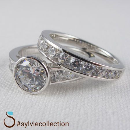 Bold and modern. Custom designed engagement ring and matching wedding band.