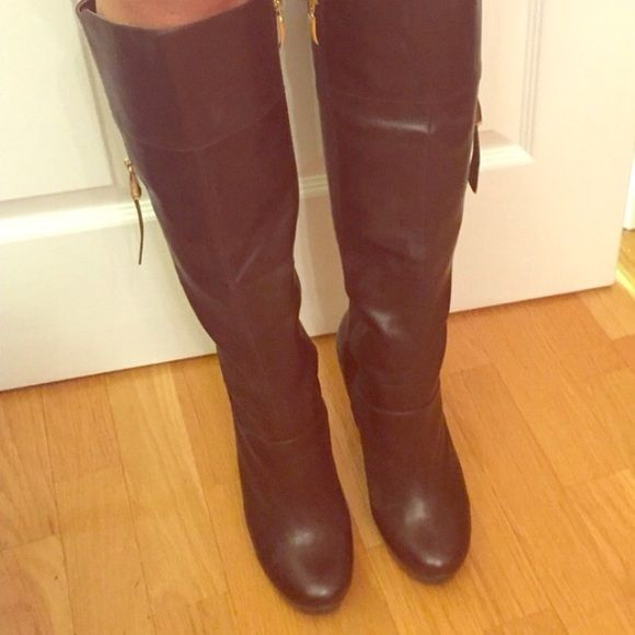 AMAZING DEAL BROWN LEATHER BOOTS WITH GOLD ZIPPER Heeled guess boots with gold zipper! Sexy comfy and stylish. They are in good condition signs of wear only on the heel and sole Guess Shoes Heeled Boots