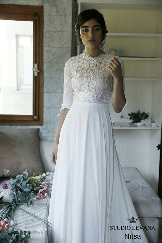 Modest simple wedding gown. Long lace sleeves, flowy skirt ...