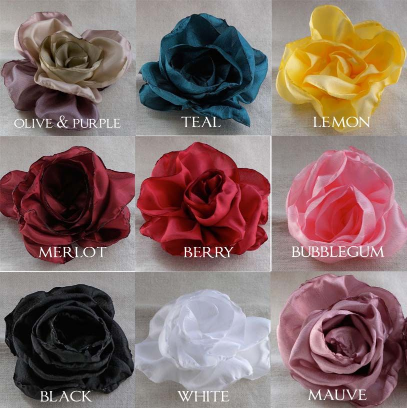 """roses: Cut a 2.5"""" x 45"""" strip of polyester material. Fold to 4"""" wide and cut one side in a scalloped shape. Unfold and taper one end about 2 petal lengths for the inside part of the rose. Singe the scallops for a pleasing ruffle. Gather the straight edge and roll into rose shape."""