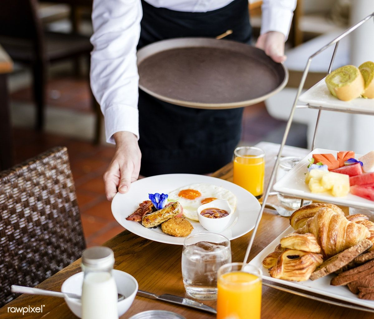 Waitress Serving Breakfast At A Restaurant Premium Image By Rawpixel